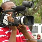 Director Saintanor Checking His Camera Settings