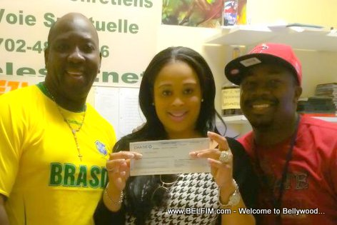 Haitian Actress Blondedy Ferdinand displays a check for Movie Sara 2