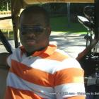 Haitian Filmmaker Tutu Demosthene Playing Golf